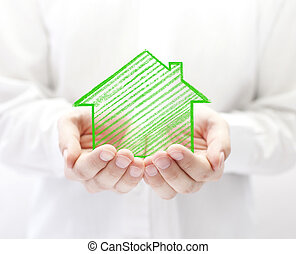 Drawing house in hands