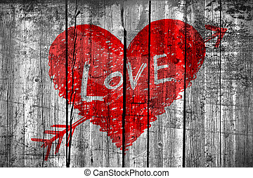 "Drawing of a heart with word ""Love"" on grunge wooden wall"