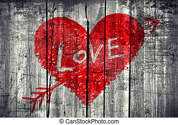 "Drawing of abstract heart pierced by an arrow with word ""Love"" on grunge wooden wall background"