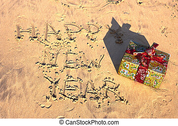 drawing on the sand with gift