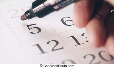 Drawing red circled mark on the fifth 5 day of a month in...
