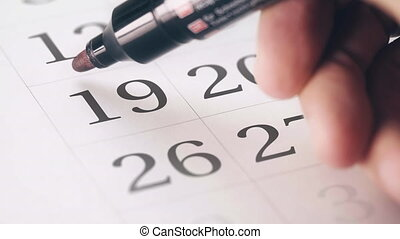 Drawing red circled mark on the nineteenth 19 day of a month...