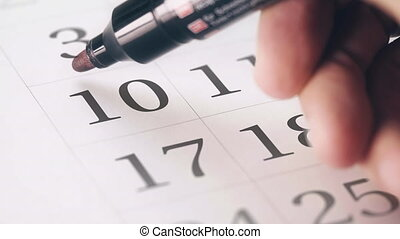 Drawing red circled mark on the tenth 10 day of a month in...
