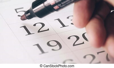 Drawing red circled mark on the twelfth 12 day of a month in...