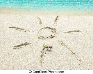 """Drawing """"SUN"""" in the sand on a tropical island, Maldives."""