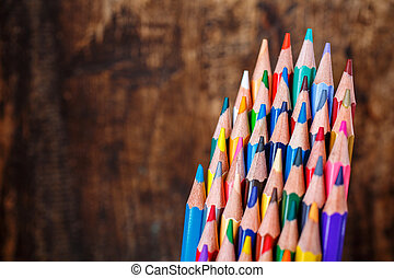 Drawing supplies: assorted color pencils. Educational background