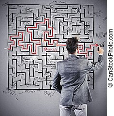Drawing the solution - Businessman drawing the solution of a...
