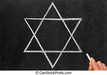 Drawing the Star of David Judaism religious symbol on a...
