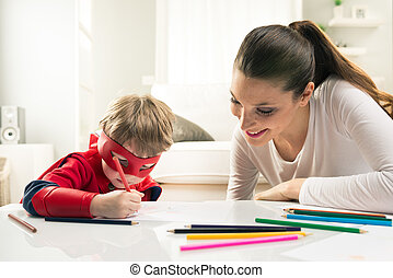 Drawing together - Mother and son drawing and enjoying time...