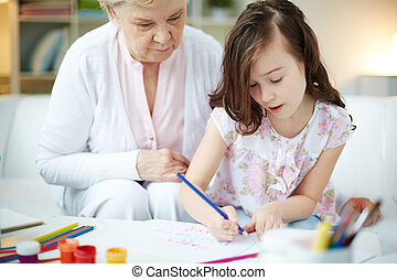 Drawing together - Portrait of cute girl drawing with ...
