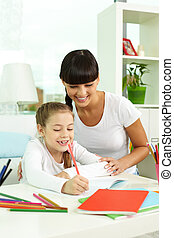 Drawing together - Portrait of happy girl drawing with ...