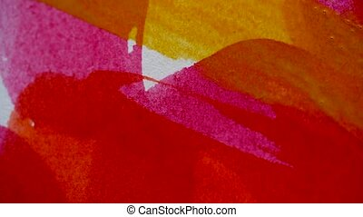Drawing with a paintbrush on white paper with red and yellow...