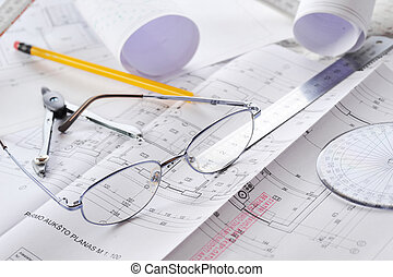 drawings-blueprints - Ruler, eraser, glasses and a pencil on...