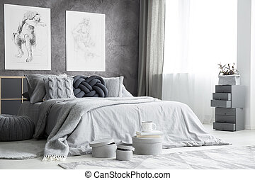 Drawings in bright bedroom interior