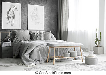 Drawings in bright grey bedroom