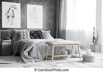 Drawings in monochromatic bedroom
