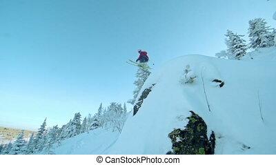 Drawn to it - Freeski rider blasting through the deep powder...