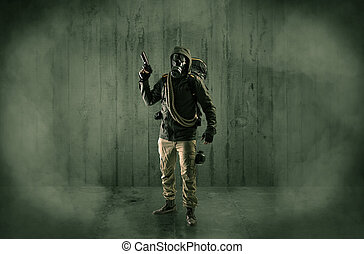 Dreadful man with mask in a wood shanty