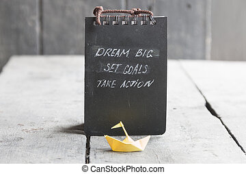 Dream Big - Set Goal - Take Action, handwriting on notebook cover