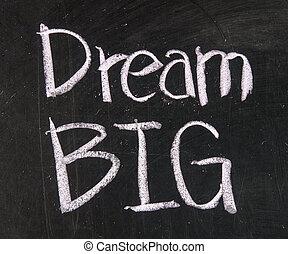 Dream big text written on a blackboard