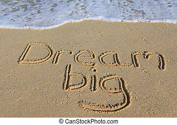 Dream big written in the sand