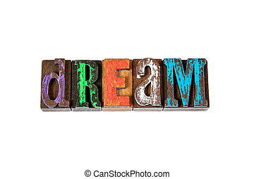 DREAM. Colored wooden letters on a white