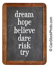 dream, hope, believe, dare, risk try on balckboard