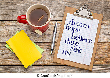 Dream, hope, believe on clipbaord