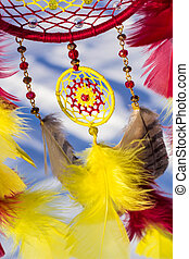 Dreamcatcher made of feathers, leather, beads, and ropes - ...