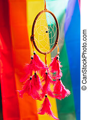Dreamcatcher on the background of rainbow flag