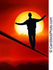 tightrope walker, artist is walking on a tighttrope