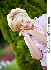 Dreaminess. Outdoor Portrait of Pensive Granny