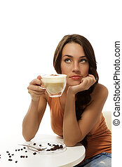 dreaming beautiful woman with a cup of cappuccino coffee on white background