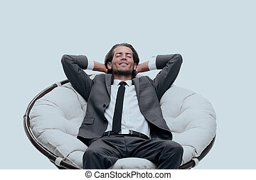 businessman resting in a comfortable chair
