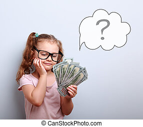 Dreaming cute kid girl in glasses looking on money and thinking how can spend its with illustration bubble and question sign above on blue background