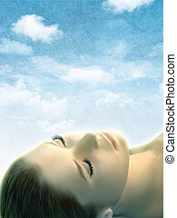 Dreaming - Female head with closed eyes over a textured sky...
