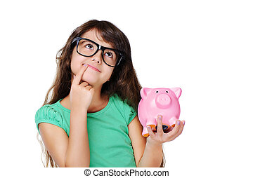 dreaming girl holding piggy bank