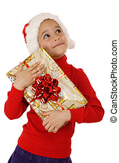 Dreaming little girl with yellow Christmas gift box, isolated on white