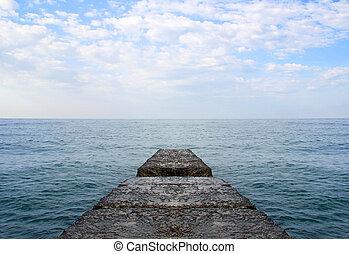 Dreaming on a empty concrete pier