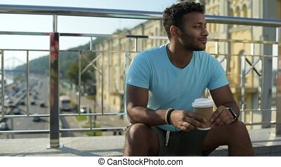 Dreaming pleasant man sitting on the concrete bench -...
