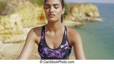 Dreaming woman in sportswear on beach - Portrait of young...