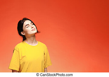 Dreaming young woman with closed eyes
