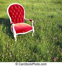 dreamlike armchair on a meadow - red velvet armchair alone...