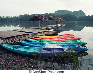 Dreammy scene colorful boat, colorful canoeing and raft on water