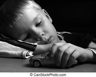 Dreams - boy playing with car toy