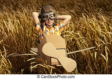 dreams come true - Brave dreamer boy playing with a ...