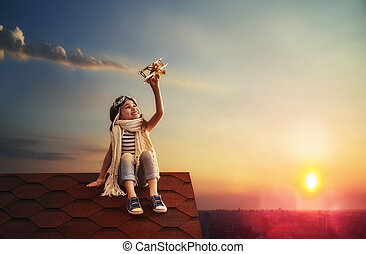 child playing with toy airplane