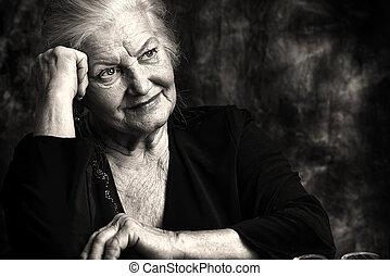 dreams - Portrait of a beautiful smiling senior woman....