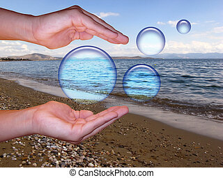 Dreams - Two hands trying to hold dreamy spheres on a beach...
