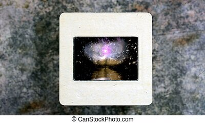 Dreamy Background Dandelion Seeds Fly Reflecting In Water on vintage slide film